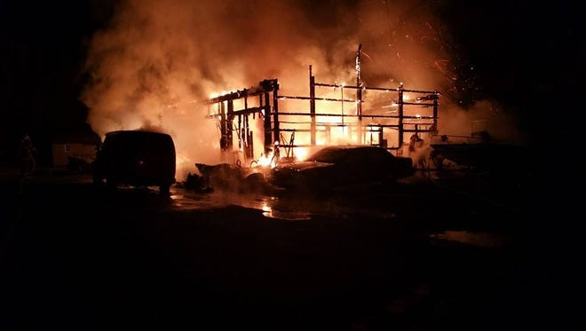 A heavy fire destroyed a pole barn west of Magnolia Saturday night.