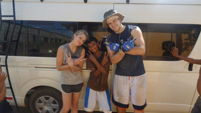 Port Huron's Alex Zmolik (right) poses for a picture while on a mission trip to Nicaragua last March.