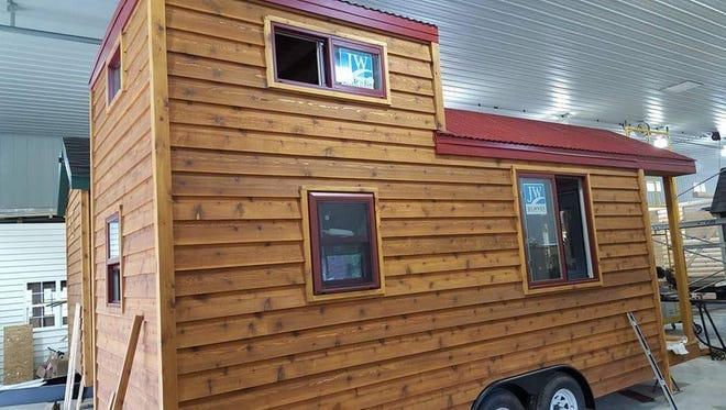 Jeff Levenhagen's tiny house includes a living room, bedroom loft, kitchen and bathroom and was built on top of a trailer.