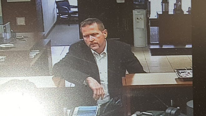 Police are asking the public to help identify this man, who they believe is involved in a case of identity theft.
