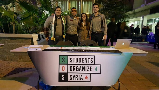 Pictured from left to right: Historian Michael Shirley, President Nour Al-Nahhas, Treasurer Farrah Karimipour  and Secretary Kamran Tate.
