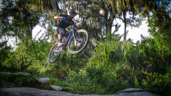 Paul Chavannes, 33, of Cocoa catches some air at the Grapefruit Trails in Palm Bay.