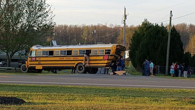 Jackson County students climb out of a school bus involved in a crash with a semi Wednesday morning in Grand Ridge