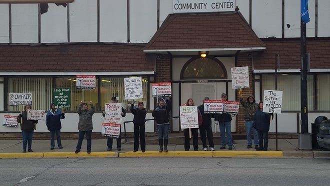 Residents picket outside a Marion Township budget meeting Monday, March 28, 2016.
