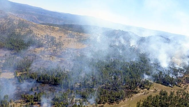 The McKenna Fire is located about eight miles west of the Gila Cliff Dwellings National Monument.