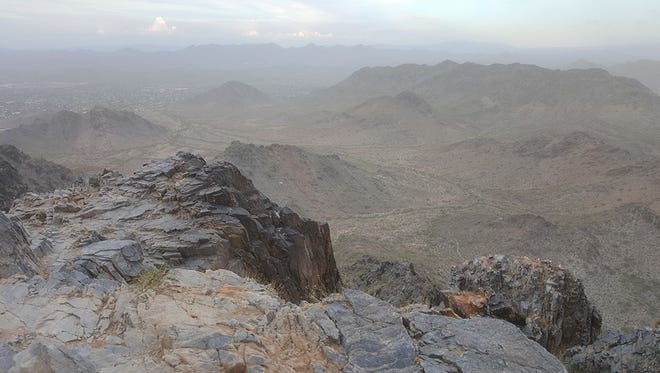 View from top of Piestewa Peak as a dust storm passes over the Valley