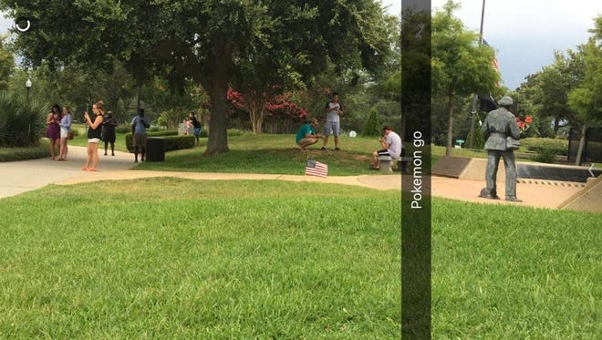 Dozens of people play #PokemonGO at Veteran's Memorial park in downtown Pensacola.
