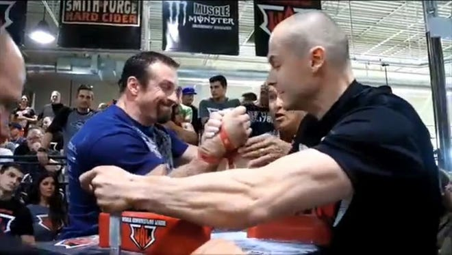 """Junction City's Tony """"Ironman"""" Kitowski (left) became a three-time world champion when he swept the right arm and left arm competitions in the zero to 165-pound weight division at the World Arm Wrestling Championships held June 23 in Las Vegas."""