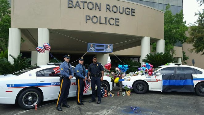 Sergeants Steve Catalano and Adam DelGuercio stand with a Baton Rouge officer. The pair flew to Louisiana to attend the funeral of Deputy Bradford Allen Garafola.