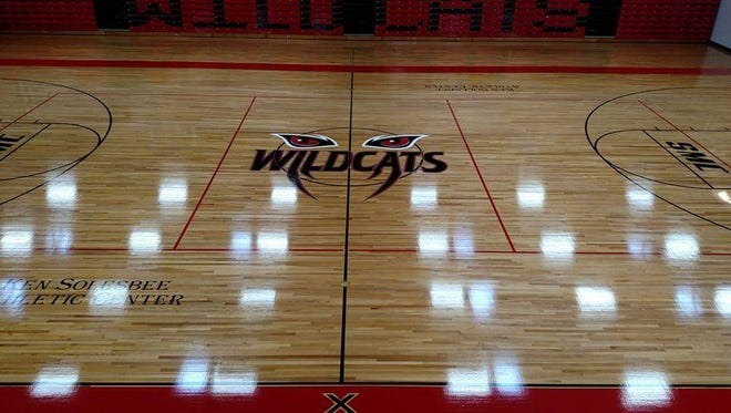 Keith Zimmerman with Appalachian Flooring sanded the court inside the Kenneth Solesbee Athletic Center. A new paint design has also been put down.