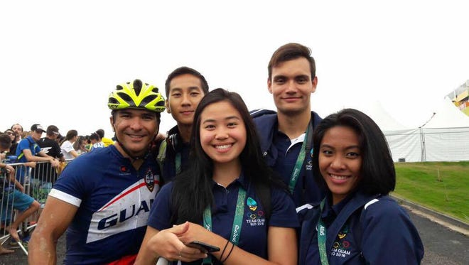 Team Guam from left, Peter Lombard, Joshua Ilustre, Pilar Shimizu, Benjamin Schulte and Regine Tugade pose for a group shot after Lombard's Olympic mountain bike race on Aug. 21.