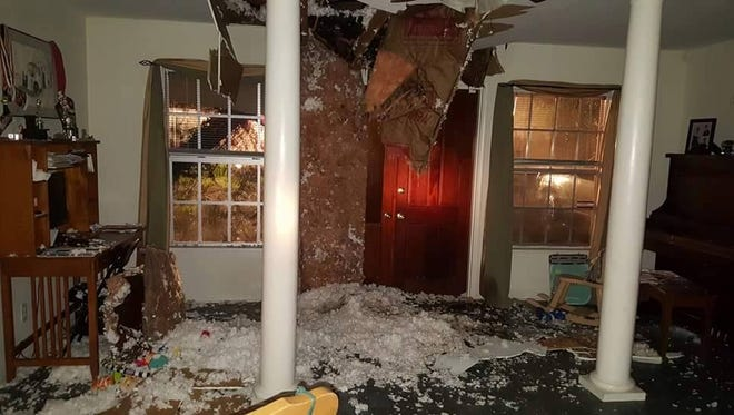 The damage when a tree fell through the roof Amy Michael Parks' Myers Park home.