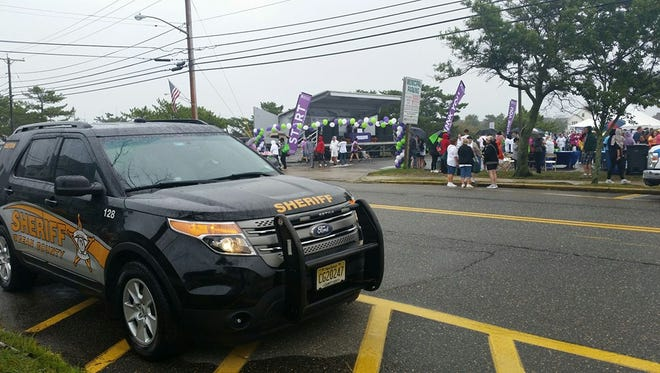 Ocean County Sheriff's officers were deployed to every major public event in the county on Saturday. Here a sheriff's officer keeps watch over Point Pleasant Beach's Walk to Fight Alzheimer's.