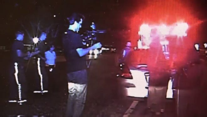A cameraman for Montgomery Police Department's reality TV show, called the MPD show, films the arrest of Jesse Davis.
