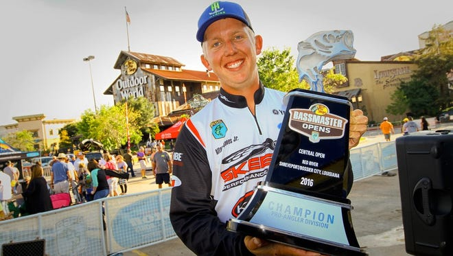 Alton Jones Jr. holds up the trophy he earned by winning last week's 2016 Bass Pro Shops Bassmaster Central Open on the Red River.