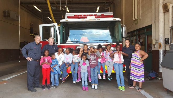"""Children from the Hilltop Lutheran Neighborhood Center, ages six through 12, visited Wilmington fire stations with handmade cards to """"spread love and appreciation,"""" said Youth Service Assistant Erin Hutt."""