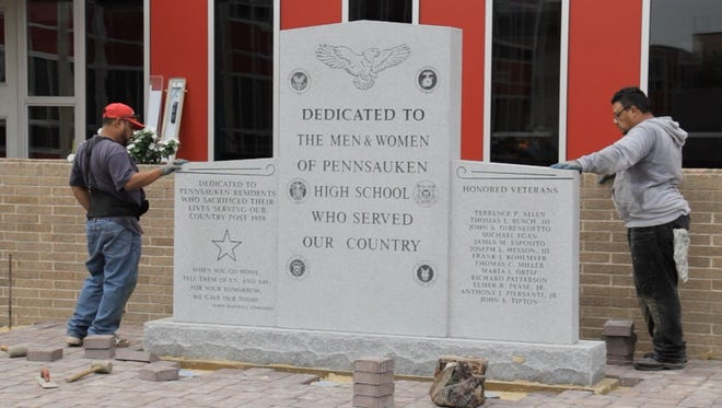 Construction progresses on a new memorial monument that will be dedicated to alumni who died in combat or in military service since the Pennsauken High School opened in 1959.