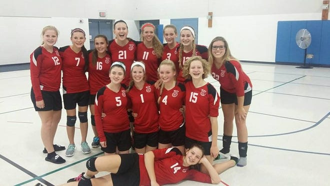 The New Life Christian Academy volleyball team poses after its victory Thursday night over Landmark Academy.