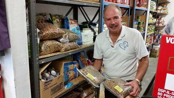 For The Love Of Paws Pet Food Pantry Director Ted Pankiewicz provides pet food to The Ecumenical Food Pantry in Roseland.