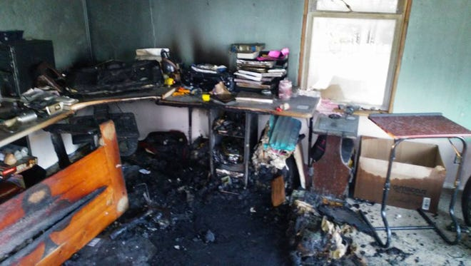 A fire quickly consumed electronics and other possessions in Ray Miettinen and Tess Fallier's home Nov. 11.