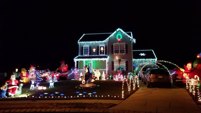 With lights that blink along to Christmas music, Santa waving in an upper window, lighted archways over the driveway and more, the Gomez family's home at 6 Natalie Lane captured the grand prize in Millville Recreation Department's annual Holiday Home Lighting Contest.