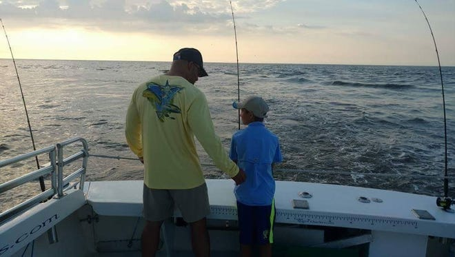 Dr. Joe Hudak of edison has a passion for fishing, a sport he shares with his father, and his son. He is pictured here with his son.