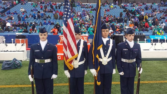 From left: Tonie Ruttkiewicz (Afton), Andre Birt (Harpursville), Benjamin Crane (Binghamton) and Travis Jones (Apalachin) present the colors during the Buffalo Bills game against the Miami Dolphins.