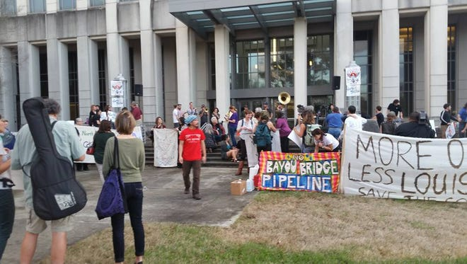 A protest outside of the public hearing in Baton Rouge about the Bayou Bridge Pipeline.