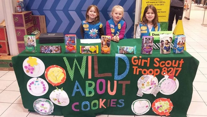 Members of Girl Scout Troop 8217 are ready to sell cookies and raise funds.