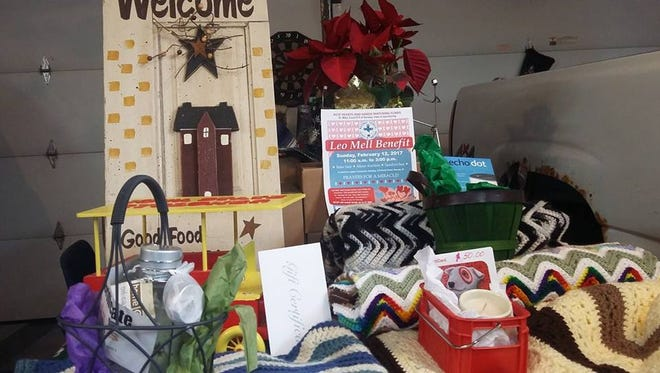 Here are some of the items which have been donated for Leo Mell's Benefit, for the silent auction. The benefit will be held on February 12th at 11 o'clock until 2:45 p.m. at which time the auction will close. Be sure to get your best bid in! So far, 4 crocheted afghans, a gift certificate, an Iowa State wagon, an oil lamp, Target gift card, candle, Echo, welded wienie grill, Prairie Creek Saloon gift certificates, art board, Nativity set, and stilted planter boxes. There will be items donated by Major League coaches and players. It will be a compilation of hand made goods, and donated goods from locals and friends of Leo Mell.
