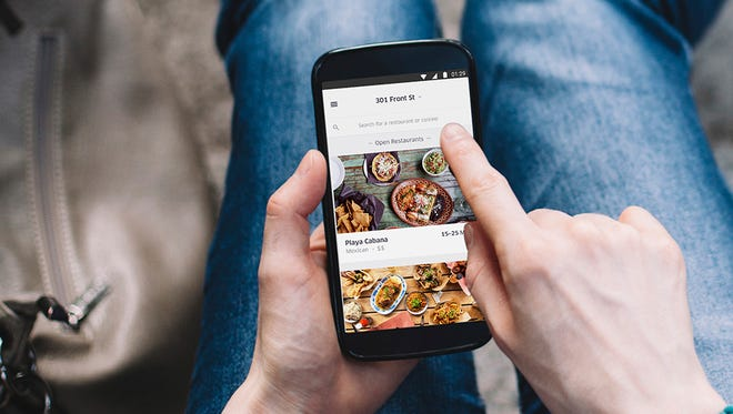 The UberEATS app lets you browse local restaurant menus and then order.