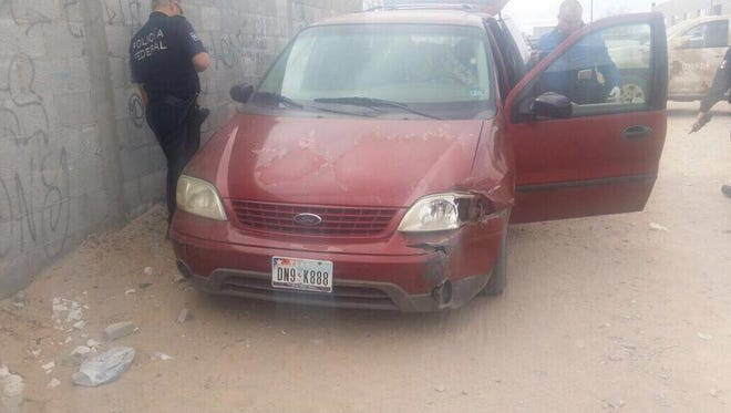 Mexican federal police search a van believed to be linked to a weekend homicide in Juárez.