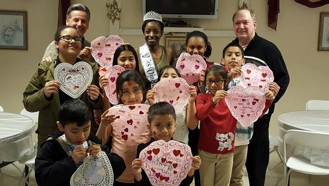 "Miss Vineland Jada Morgan discussed her platform ""Children's Education"" with boys and girls from the Salvation Army after school program. She explained the importance of paying attention in class, completing homework, studying and more. After she spoke to the children, she helped them design special Valentine's Day hearts."