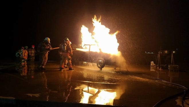 Area firefighters participate in a recent training exercise.