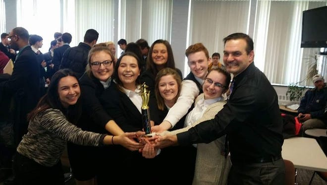 Members of the Capac A Mock Trial team celebrate their win at the Oakland County Regional.