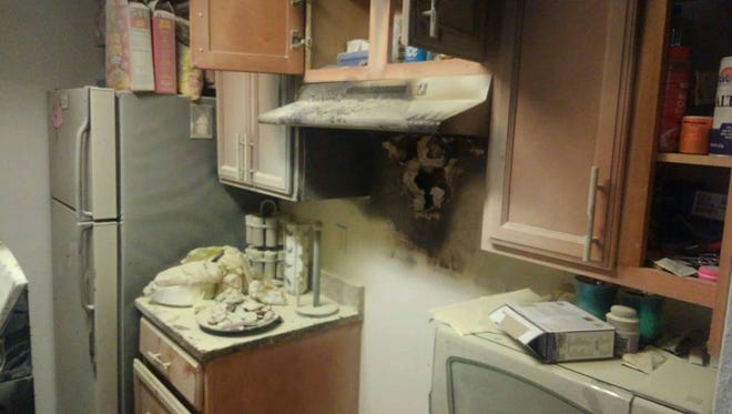Fire-suppression material from a fire extinguisher coats the areas where a stove caught on fire in a Stuart apartment Thursday, May 4, 2017.