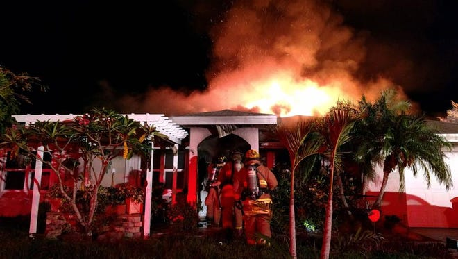 St. Lucie County Fire District crews battle a house fire in the 400 block of Southeast Whitmore Drive in Port St. Lucie that began about 11 p.m. Friday, May 12, 2017.
