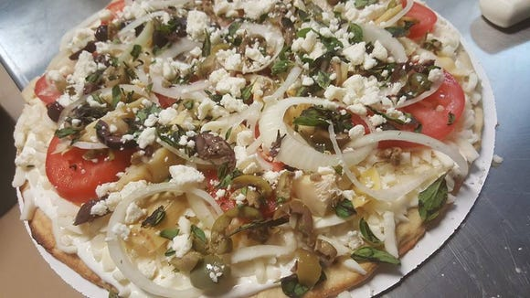 The Milwaukee Pizza Co.'s Greek pizza. It was known for its frozen pizzas, but the company now will serve fresh, made to order pizzas at its cafe, 309 W. Main St., Waukesha.