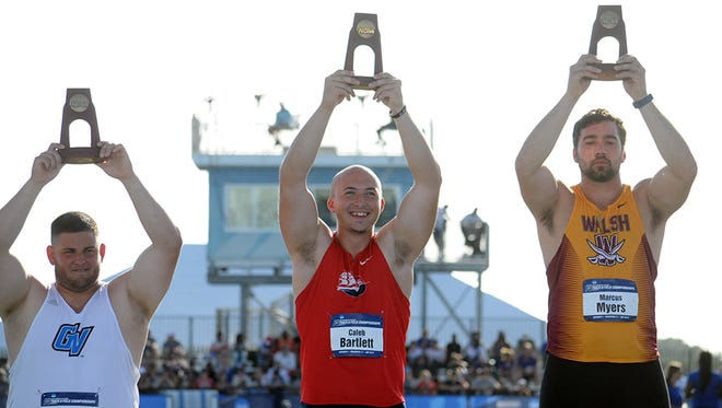 Greencastle native Caleb Bartlett raises his NCAA trophy after placing sixth at the 2017 NCAA outdoor Division II championships.