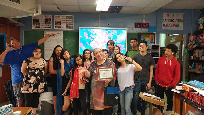 Maria Alford, an art teacher at Carroll High School, earned the Texas AFT's Pride in Public Education Award.
