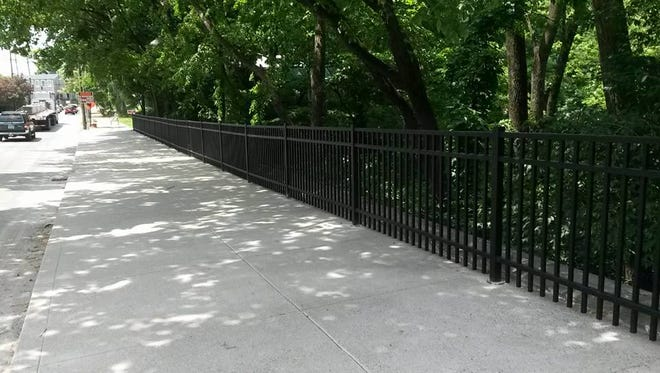 Repaired and restored fencing and sidewalk along Frankfort Avenue at Beargrass Creek