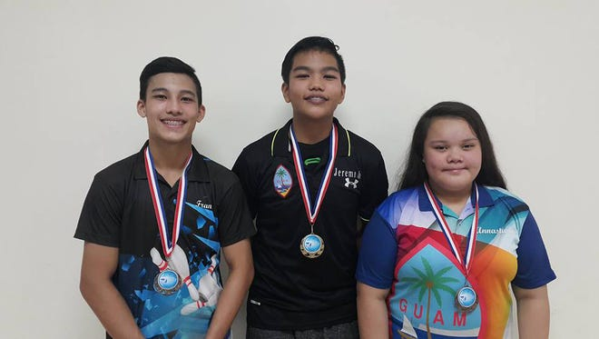 The Triple J Guam Youth Bowler of the month top three winners, from left, second place Frank Manibusan Jr., Champion Jeremiah Camacho and third place Annastashia Leon Guerrero.