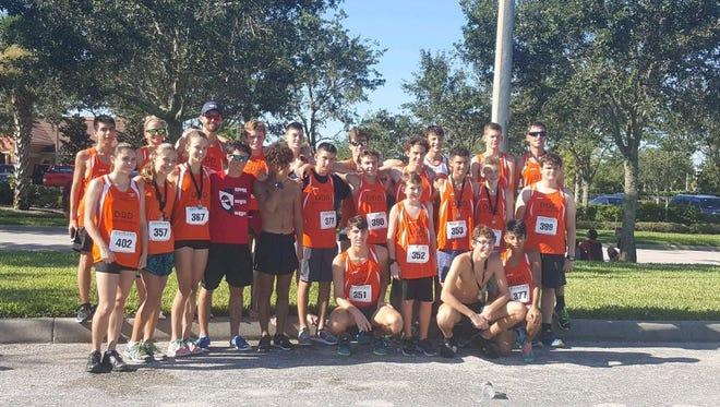 The Estero boys and cross country teams pose for a photo after completing a road race the Wildcats used as a training session for the upcoming season. The Wildcats compete in the season-opening Jim Ryun Invitational on August 26 in Lakeland.