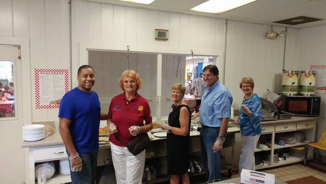 Twelve Rotarians and their family and friends participated in setting up, serving, cleaning up, and visiting with the approximately 60 campers, counselors and staff