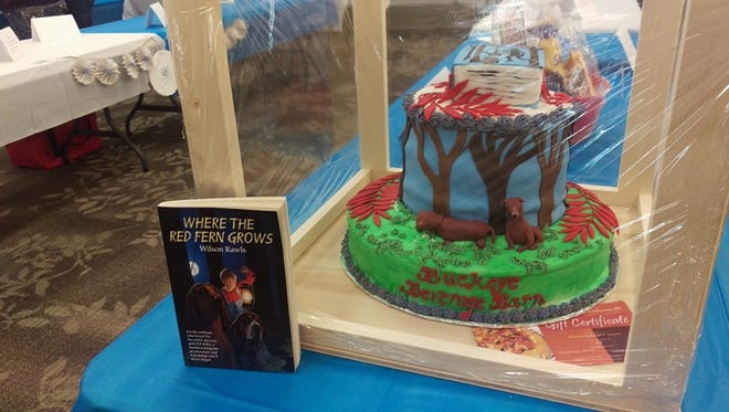 """A cake based on """"Where the Red Fern Grows"""" from the 2016 BPW Cake Auction. The next event will be at 2 p.m. Sept. 23 at the Frontier Power Community Room."""