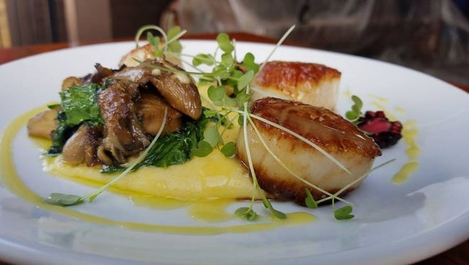 A scallop entree, served with creamy grits, confit mushrooms and blackberries at The Original, 2498 N. Bartlett Ave., where drink pairings are suggested for menu items.
