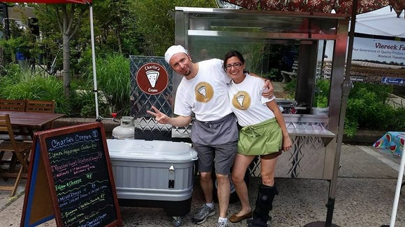 Charles Koory and Lisa Ciacciarelli Koory share a laugh in front of their Charlie's Crepes truck at the Collingswood Farmers Market. The couple will open a crepe cafe in Merchantville in the spring.