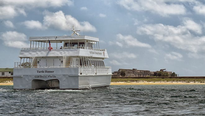 The National Park Service ferry boat Turtle Runner sits off shore of Fort Pickens while being delivered to Pensacola Bay on April 22, 2017.