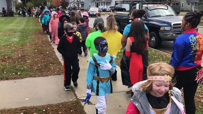 Woodrow Wilson students walk in the Halloween parade.