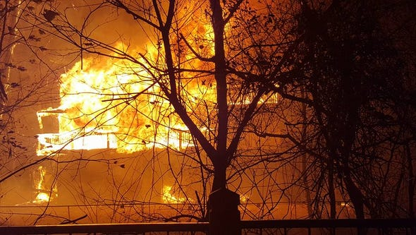 Flames consume the River House motel at the corner